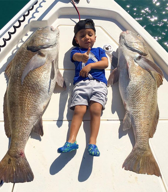 Boy with fish at the River Fishing Charter in Cocoa Beach