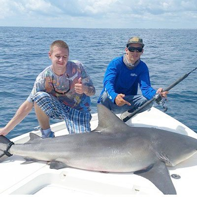 Father and Son at the Shark Fishing Charter
