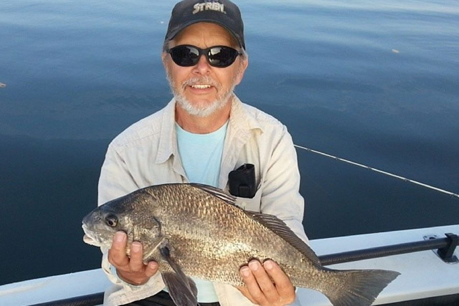 Man holding black drum at the River Fishing Charter in Cape Canaveral