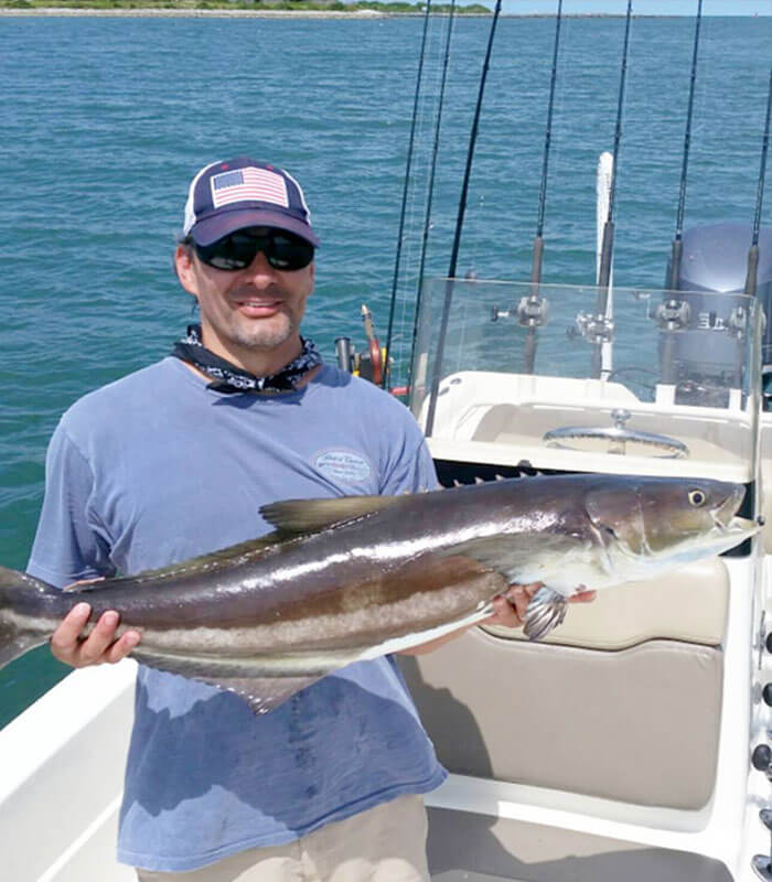 Man holding Cobiaa at the Deep Sea Fishing Charter in Cocoa Beach