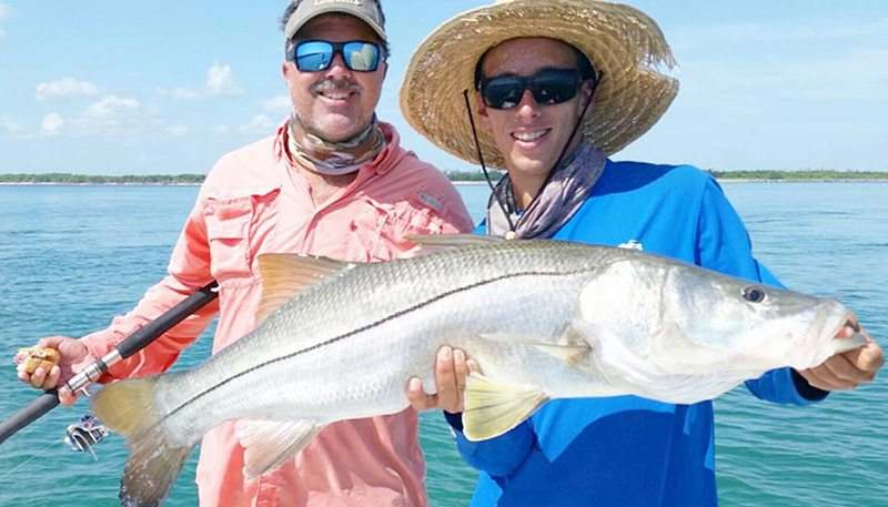 Men holding snook at the Orlando Fishing Charter