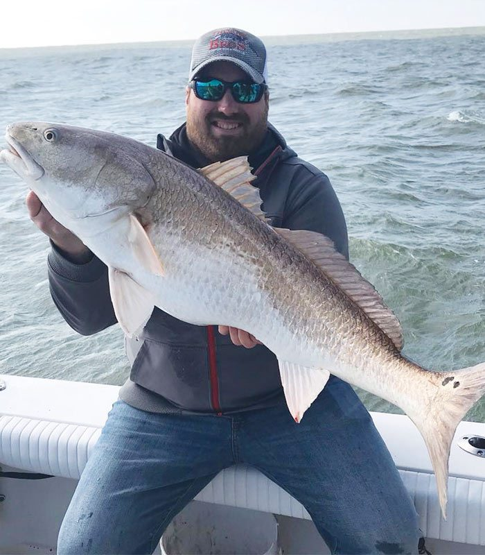 A man caught redfish in the Mosquito Lagoon
