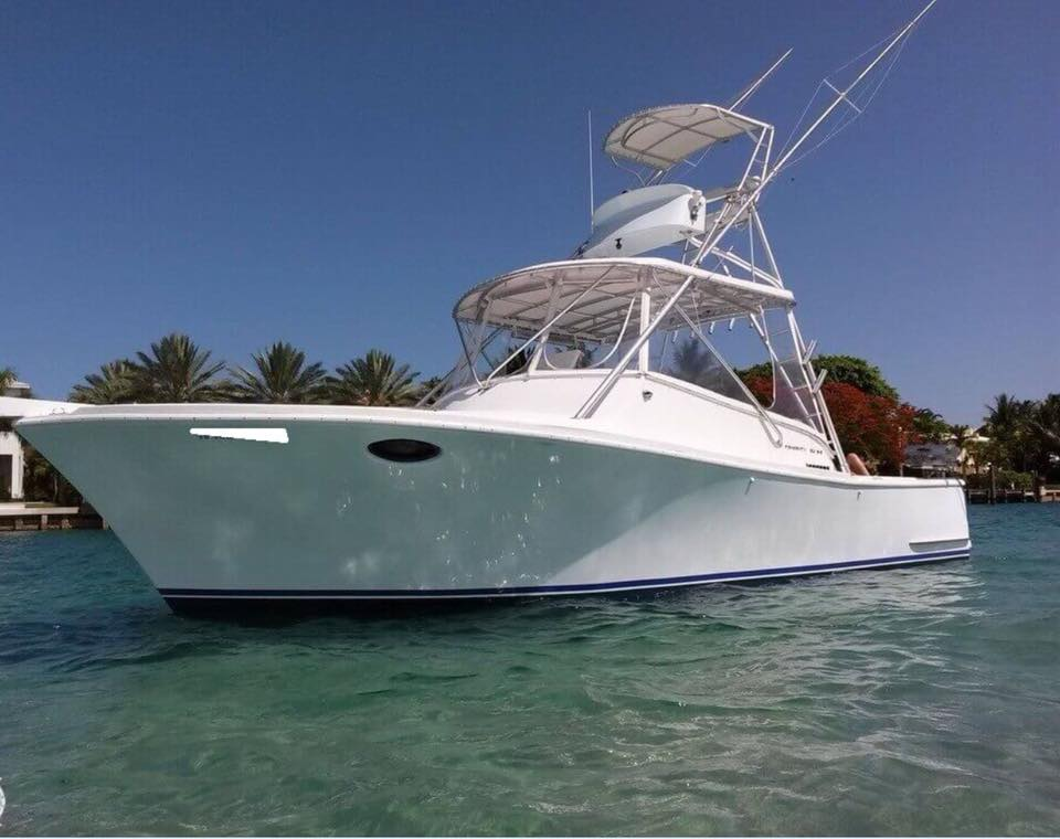 Central Florida deep sea fishing large white boat on green blue water
